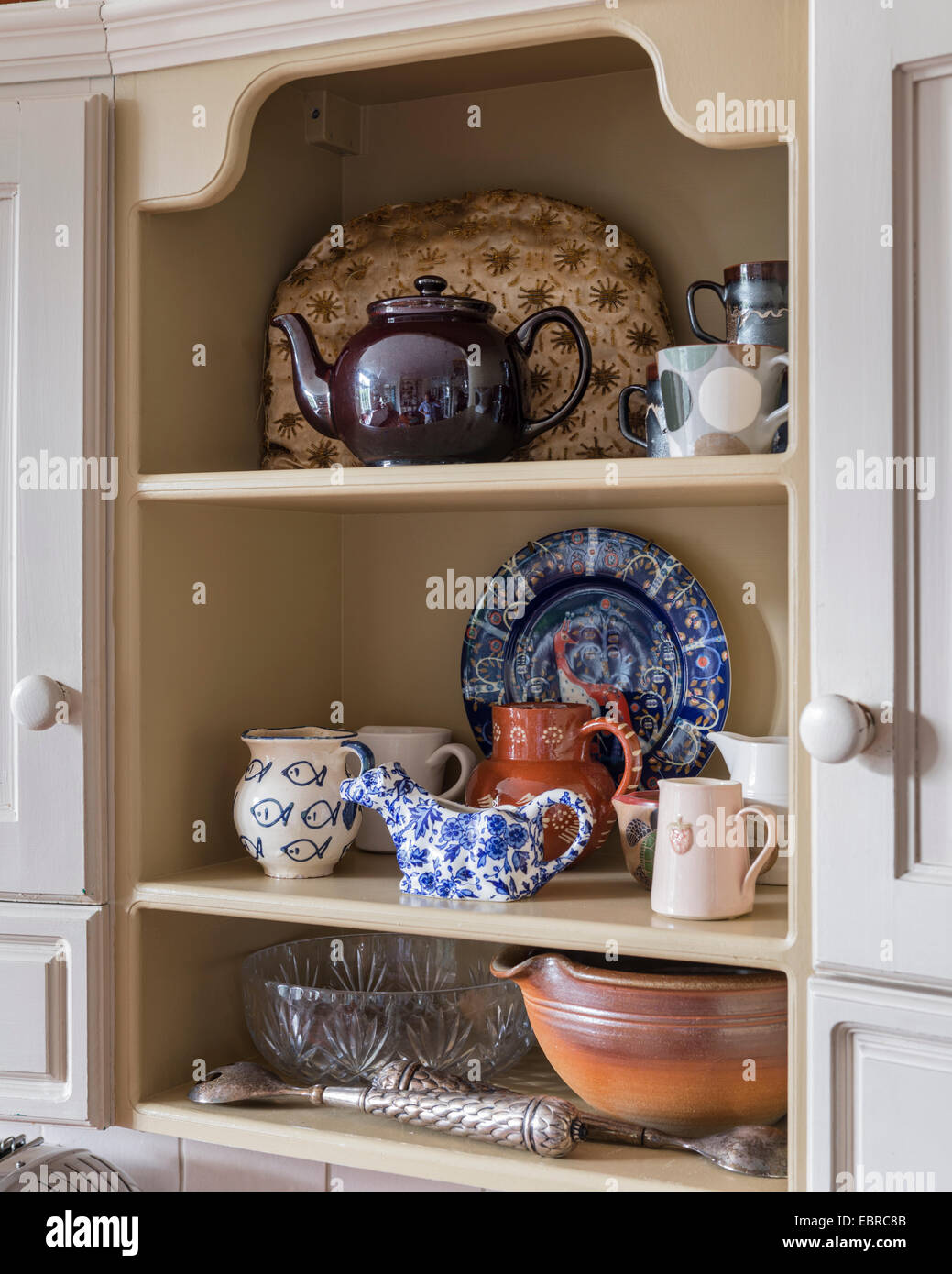 Kitchen and chinaware on recessed shelf - Stock Image