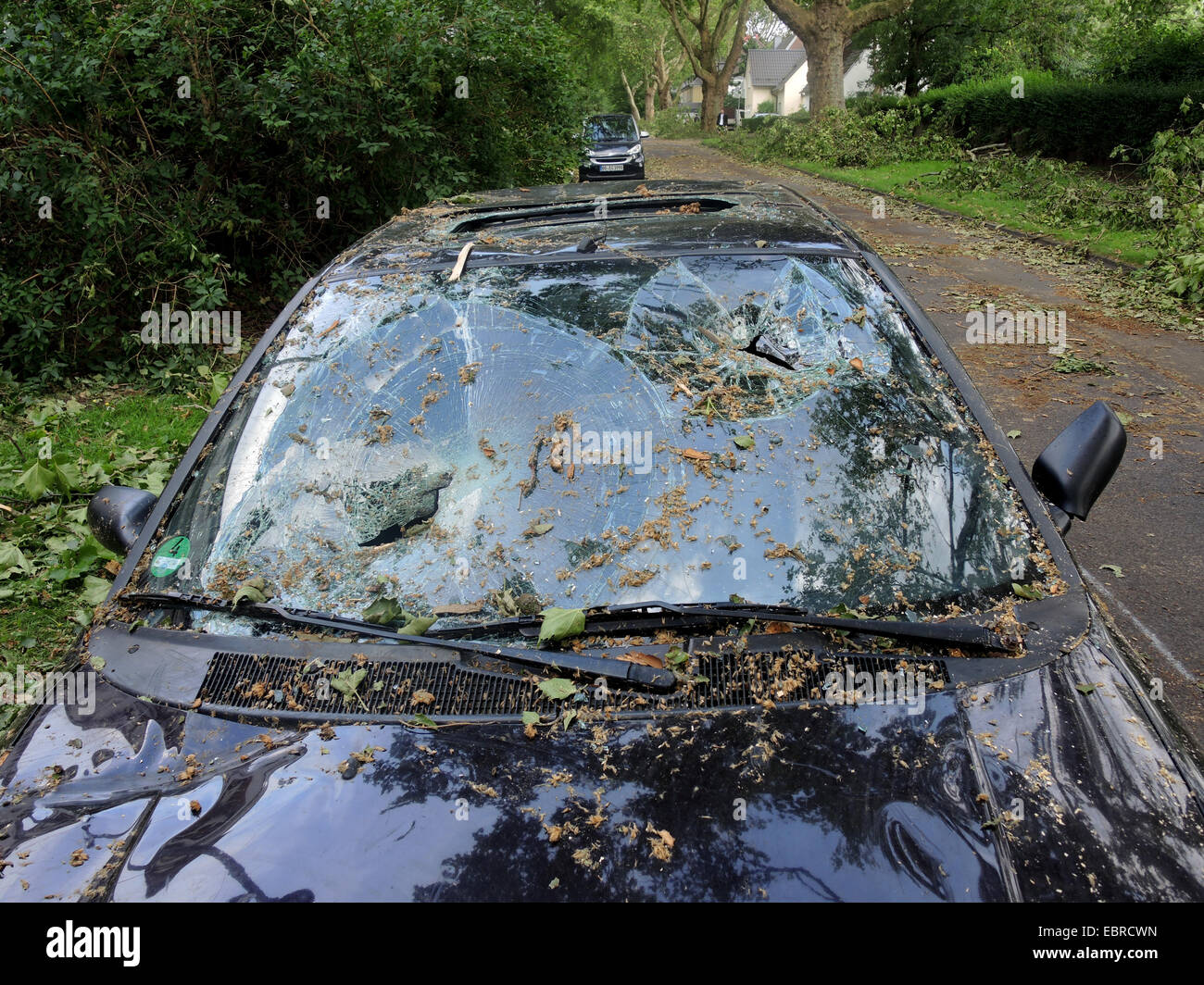 car with broken windscreen, damages by storm front Ela at 2014-06-09, Germany, North Rhine-Westphalia, Ruhr Area, - Stock Image