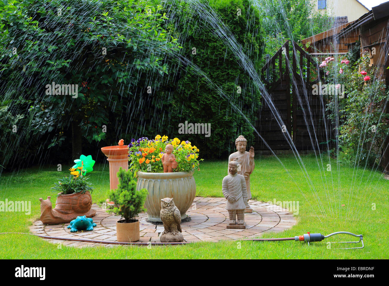 sprinkling lawn and garden decoration, Germany Stock Photo