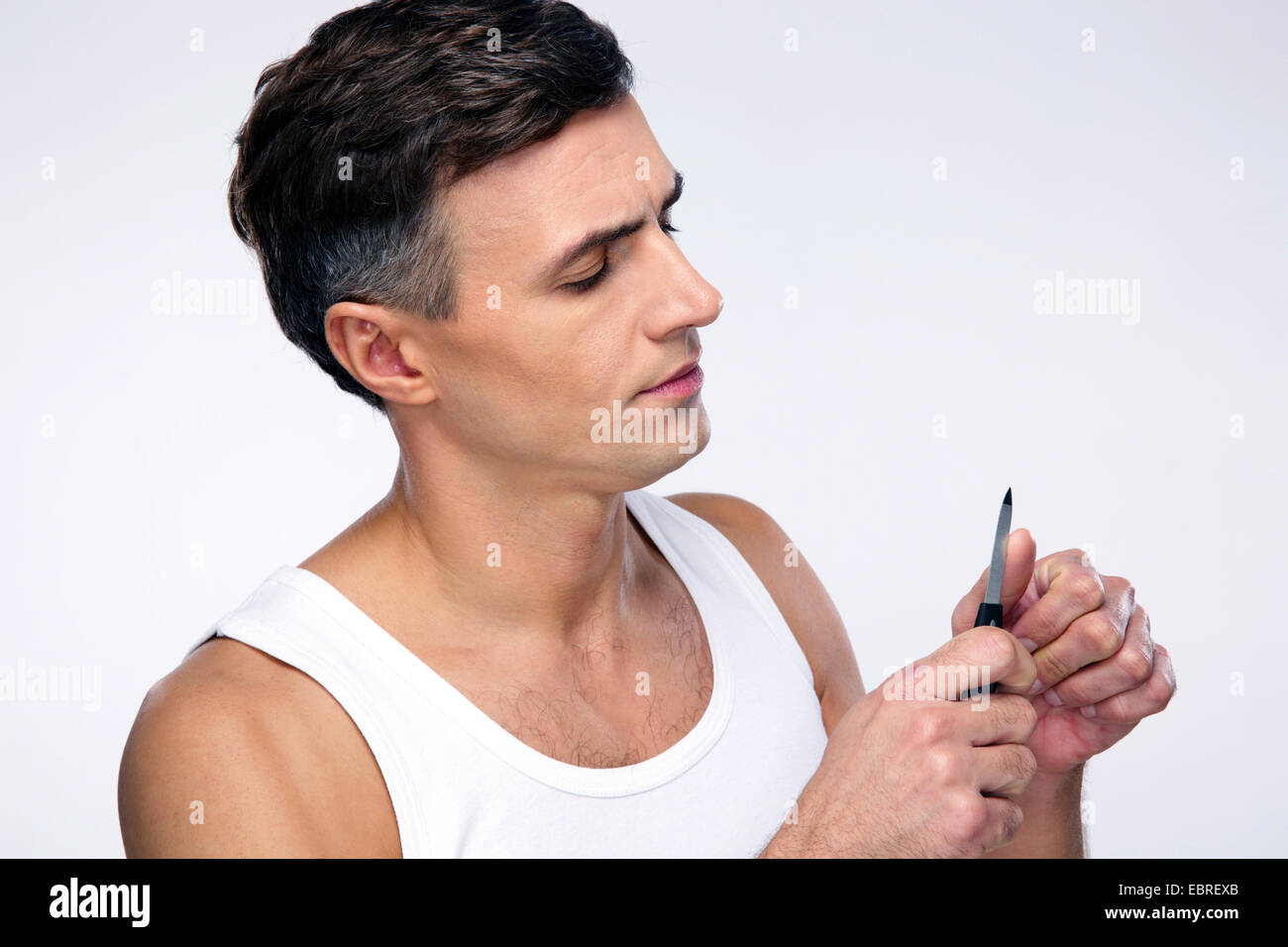 Man doing manicure over gray background - Stock Image
