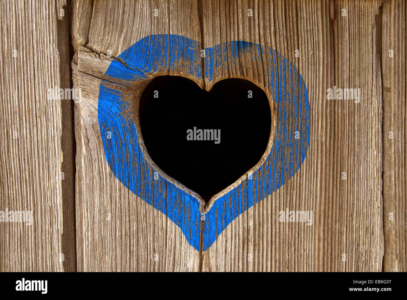 vent hole in the shape of a heart at a wooden door of an outhouse, Germany, Bavaria, Oberbayern, Upper Bavaria - Stock Image