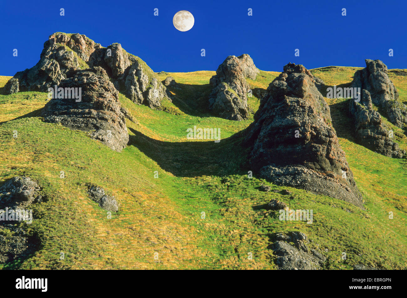 rock formation at Pordoi Pass with full moon, Italy, South Tyrol, Dolomites - Stock Image