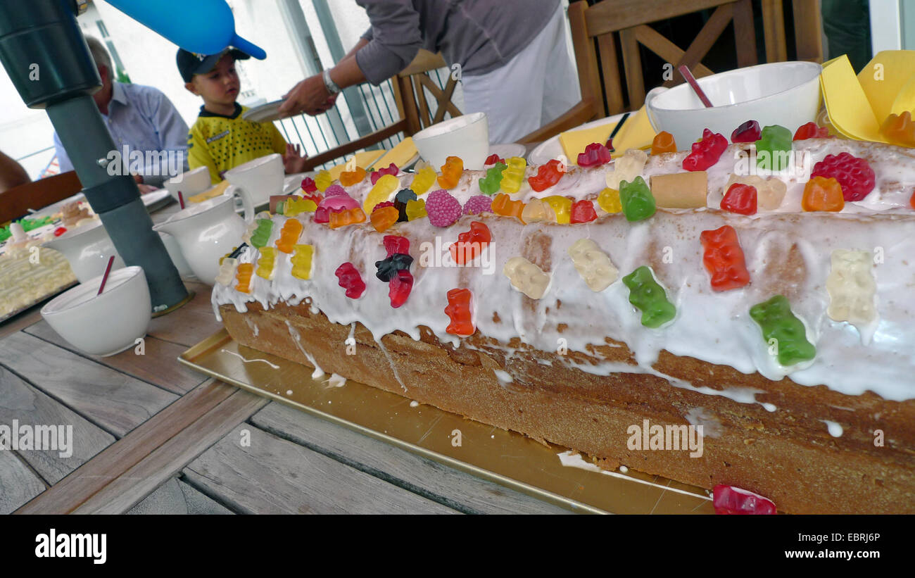 elaborate fancy cake on a little boy's birthday - Stock Image