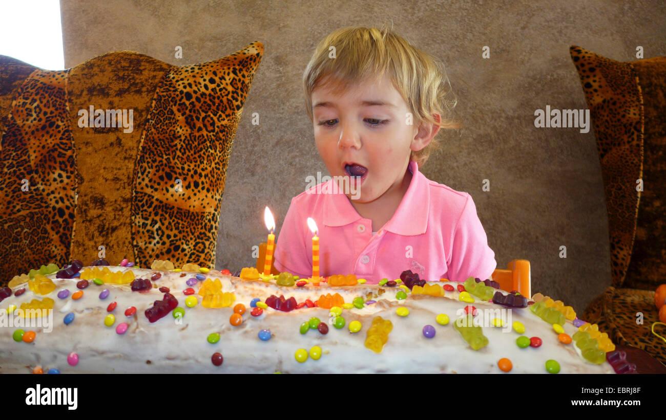 little boy with giant birthday cake - Stock Image