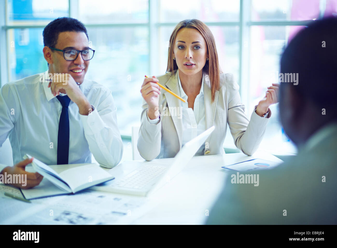 Businesswoman expressing her opinion at meeting - Stock Image