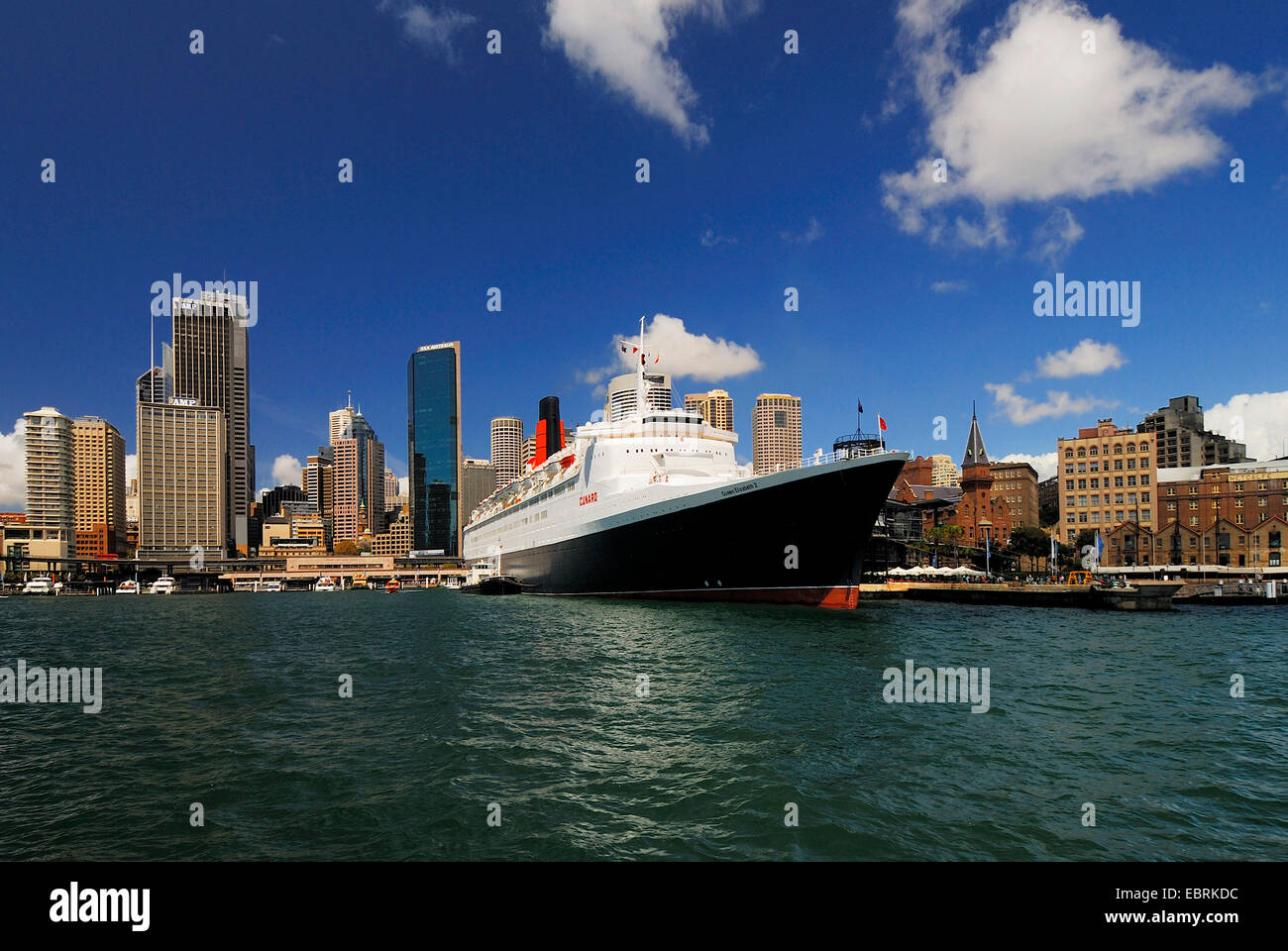 Queen Elizabeth 2 ocean liner in front of the skyline of Sydney, Circular Quay, Sydney Cove, Australia, New South - Stock Image