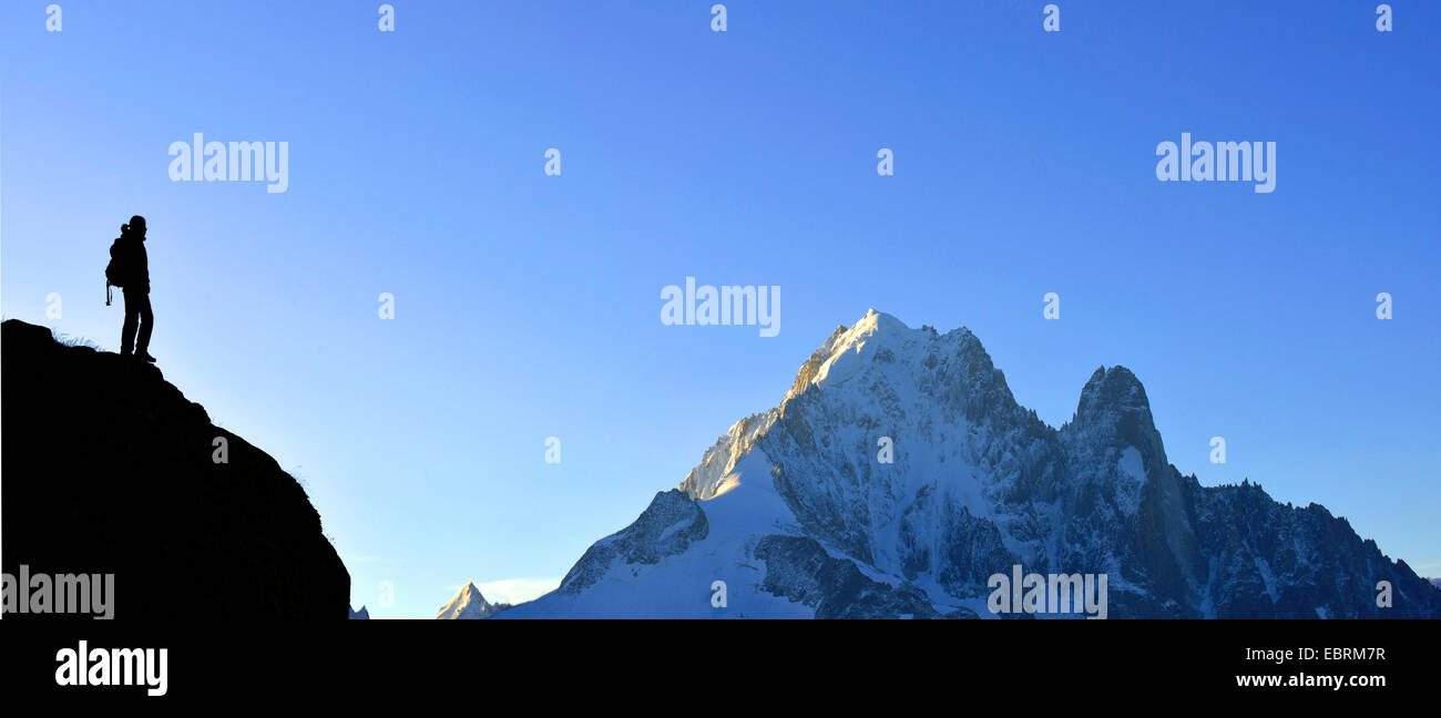 silhouette of mountaineer in front of Aiguille Verte, France, Haute-Savoie, Chamonix - Stock Image