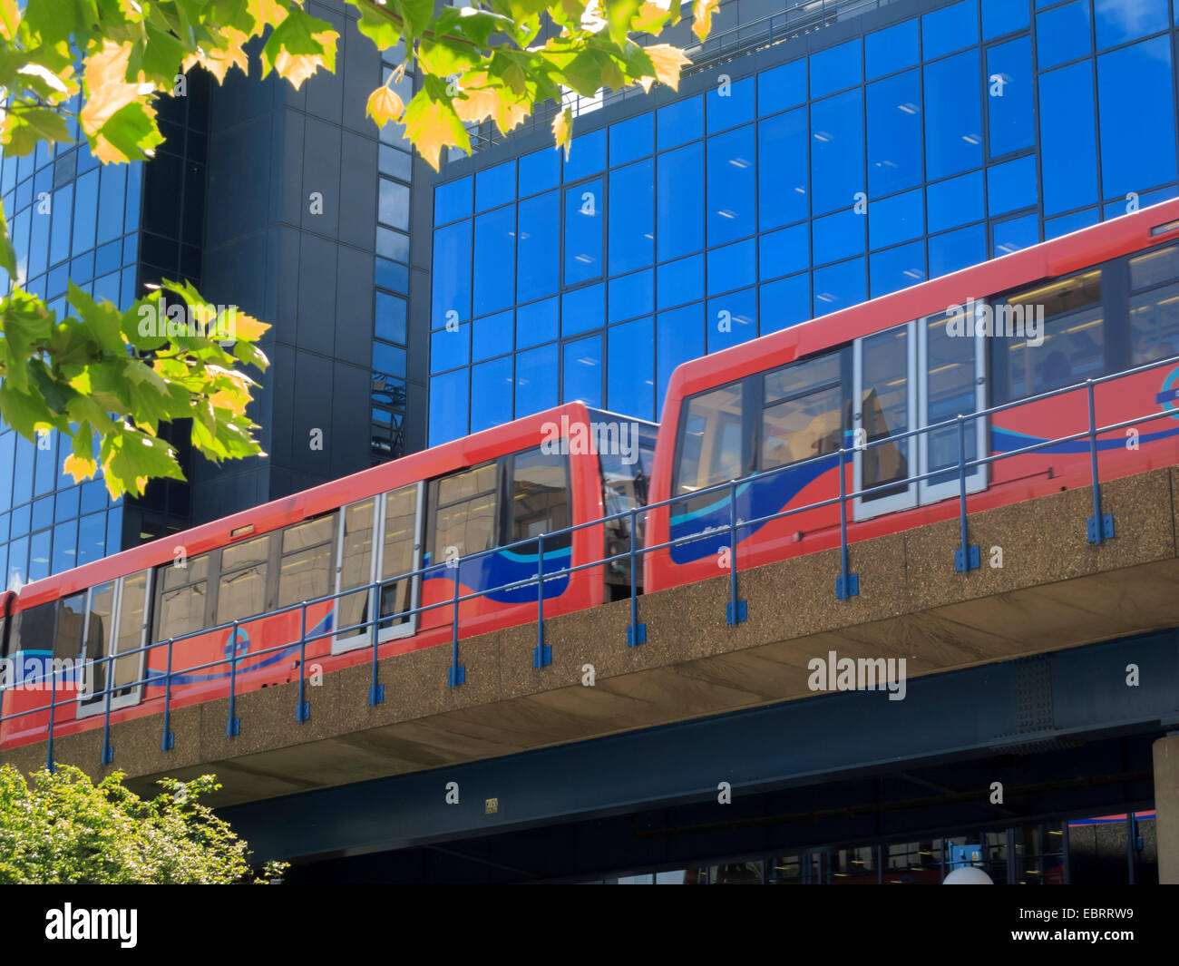 DLR Train at Canary Wharf Office Buildings London England - Stock Image