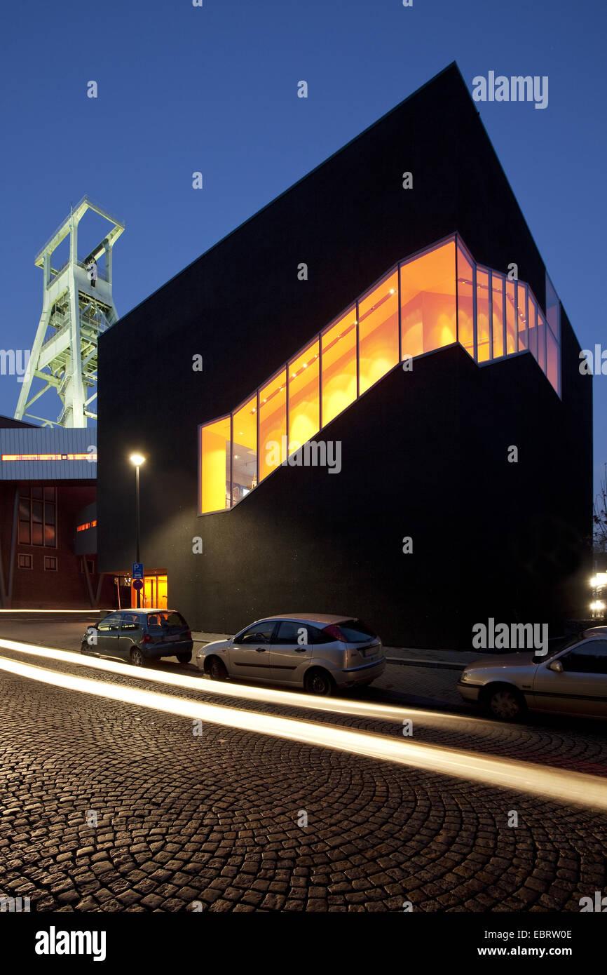illuminated German mining museum with 'Black Diamond' in twilight, Germany, North Rhine-Westphalia, Ruhr Area, Bochum Stock Photo