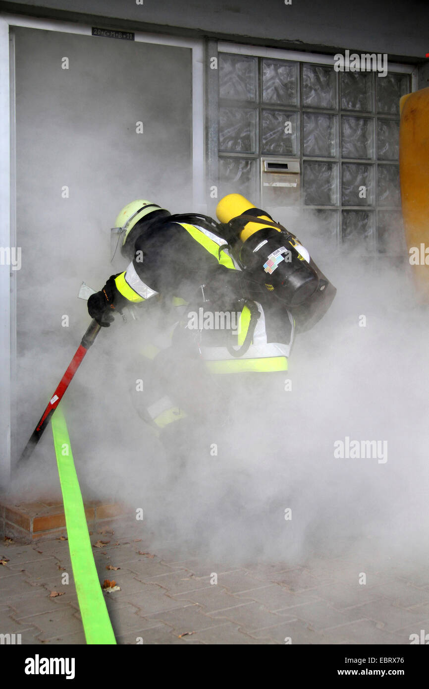 firefighting exercise with protective respiratory equipment, Germany - Stock Image