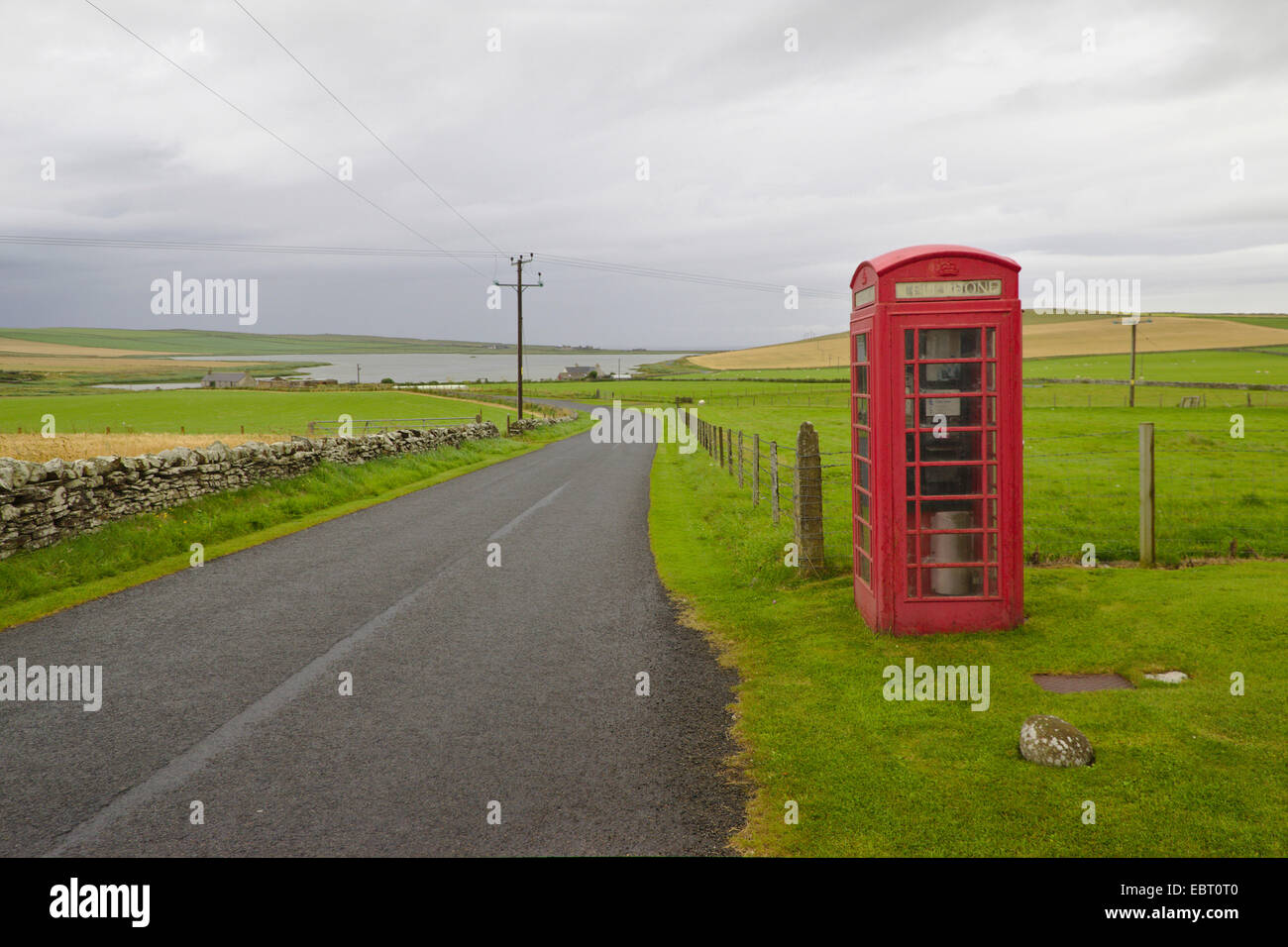 lonely phone box beside a country road, United Kingdom, Scotland, Orkney, Orkney Mainland - Stock Image