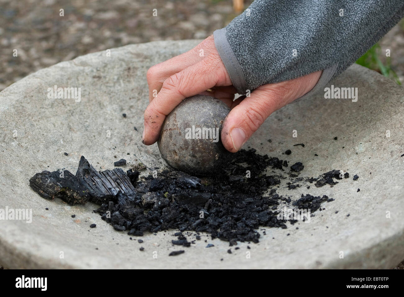 grinding charcoal to paint with earth colour, Germany - Stock Image