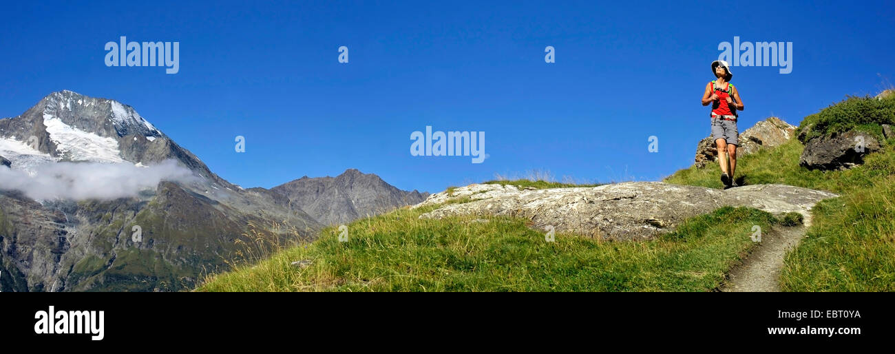 female hiker on trail near Mont Pourri, France, Savoie, Vanoise National Park, Sainte Foy Tarentaise - Stock Image