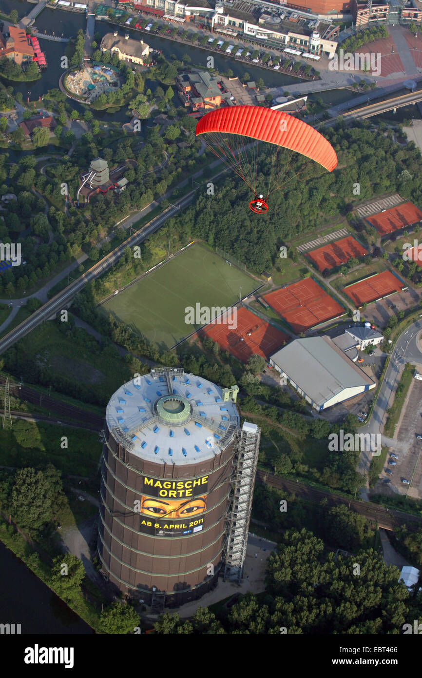 Powered Paraglider Over Gasometer With Tennis Court Sports Field