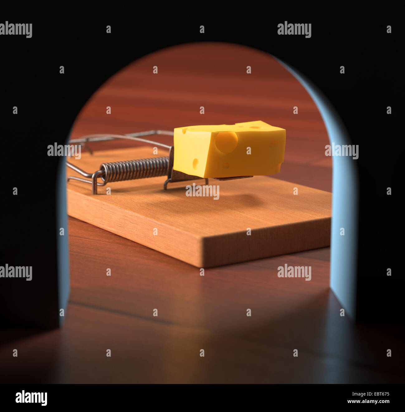 Looking from the hole, the mousetrap with cheese across the wall. - Stock Image