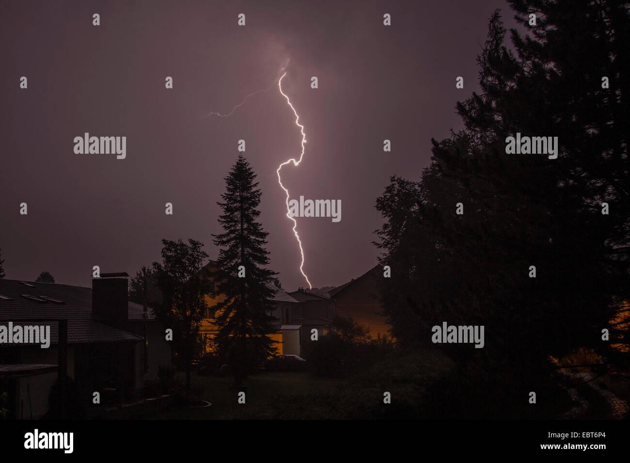 lightning strike in a housing area, Germany, Bavaria, Isental - Stock Image
