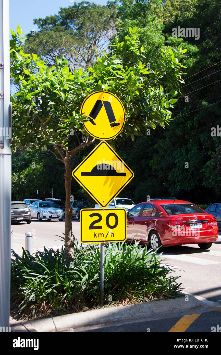 A red car drives over a pedestrian crossing in Darwin, Northern Territory, Australia. Stock Photo