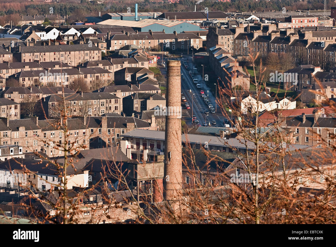 """Early Winter landscape view of 1800`s jute mill chimney and tenement housing from """"The Law"""" Cenotaph in Dundee, - Stock Image"""