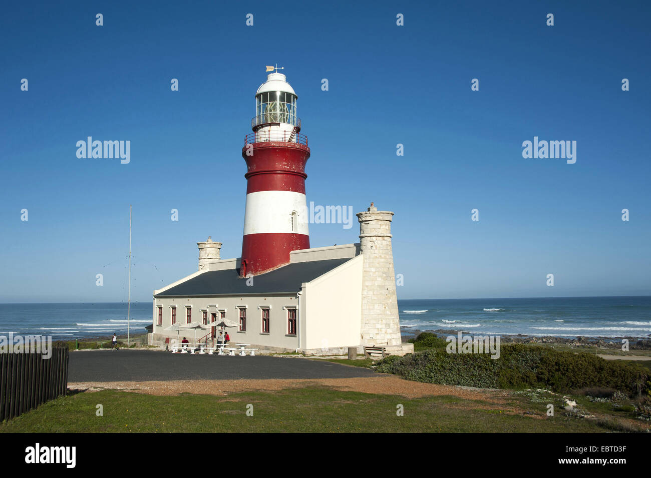lighthouse at Cape Agulhas, the most southerly place in Africa which also marks the border between the Atlantic - Stock Image