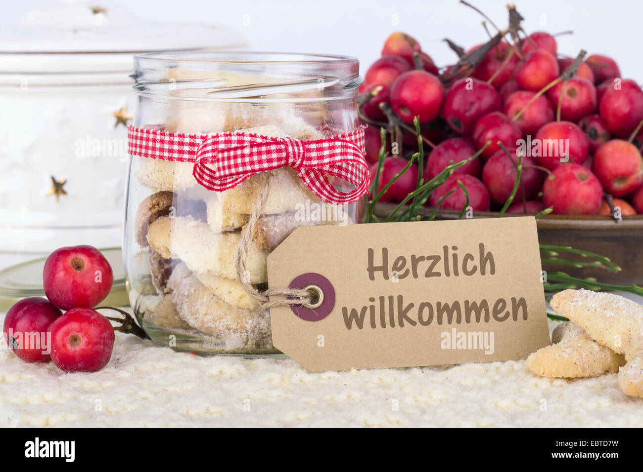 vanilla crescents and apples with german text warmly welcome - Stock Image