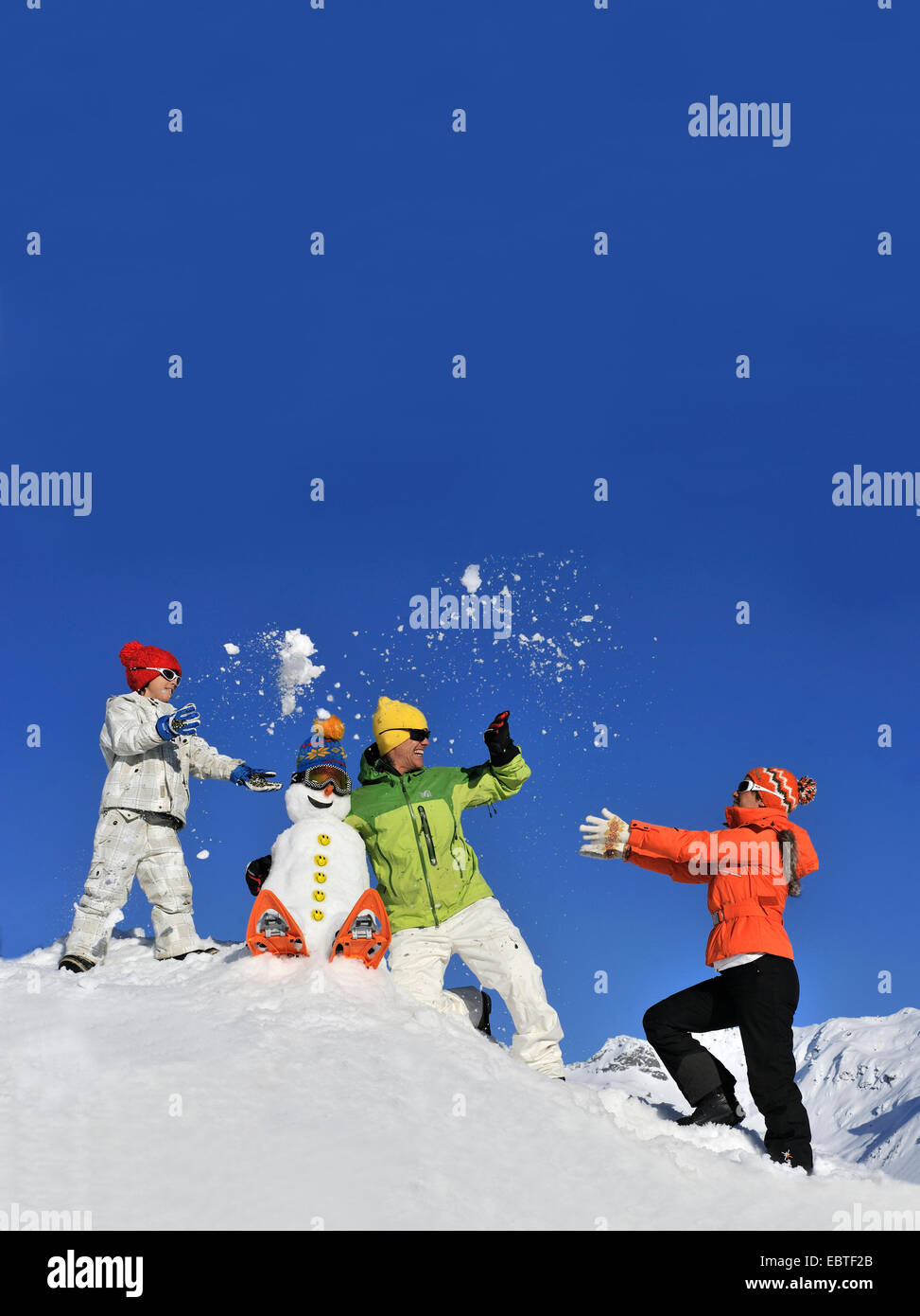 family doing a snowball fight , France - Stock Image