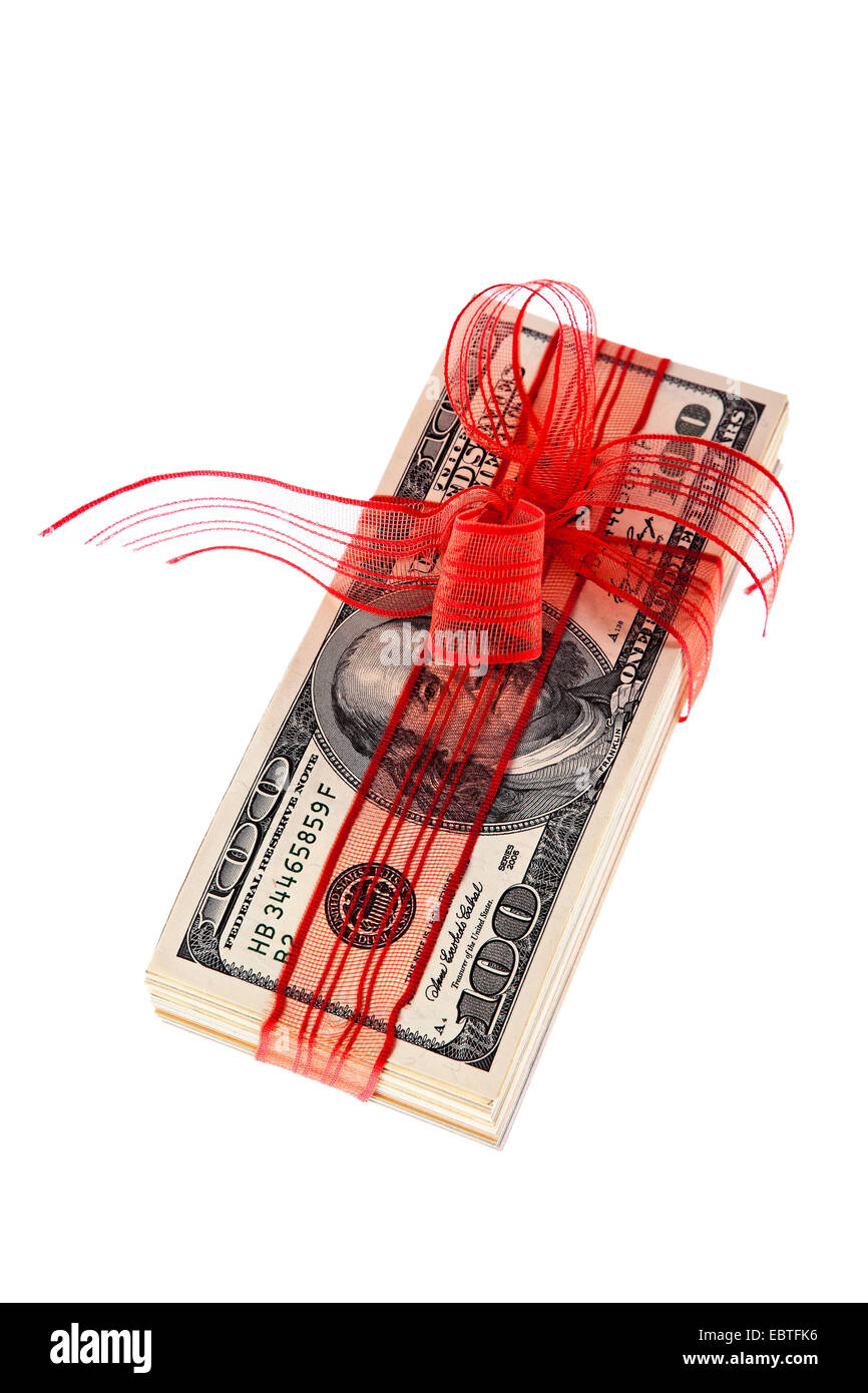 wad of Dollar banknotes with red gift ribbon, USA - Stock Image