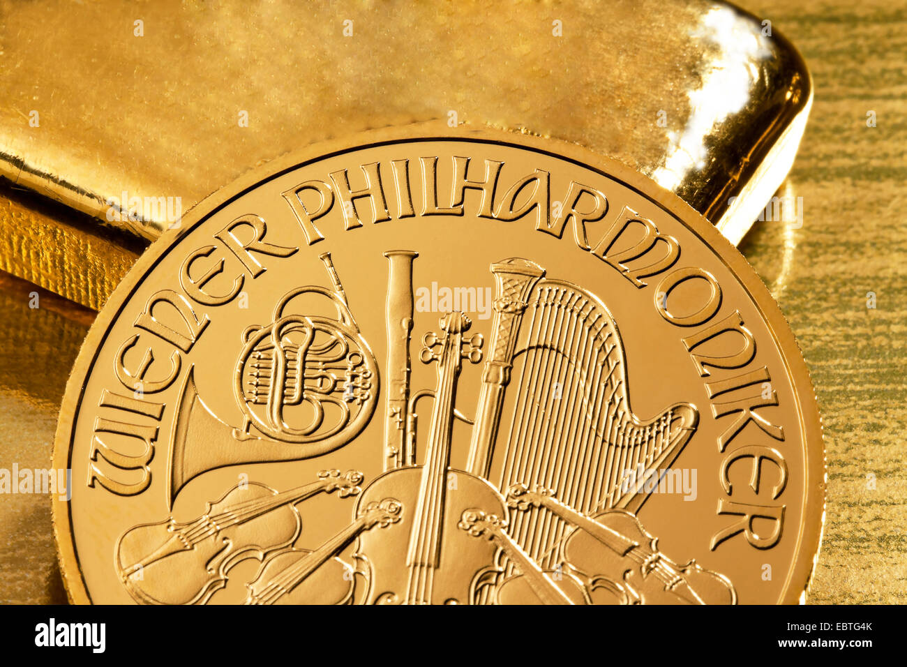 gold bullion and gold coin of Wiener Philharmoniker - Stock Image