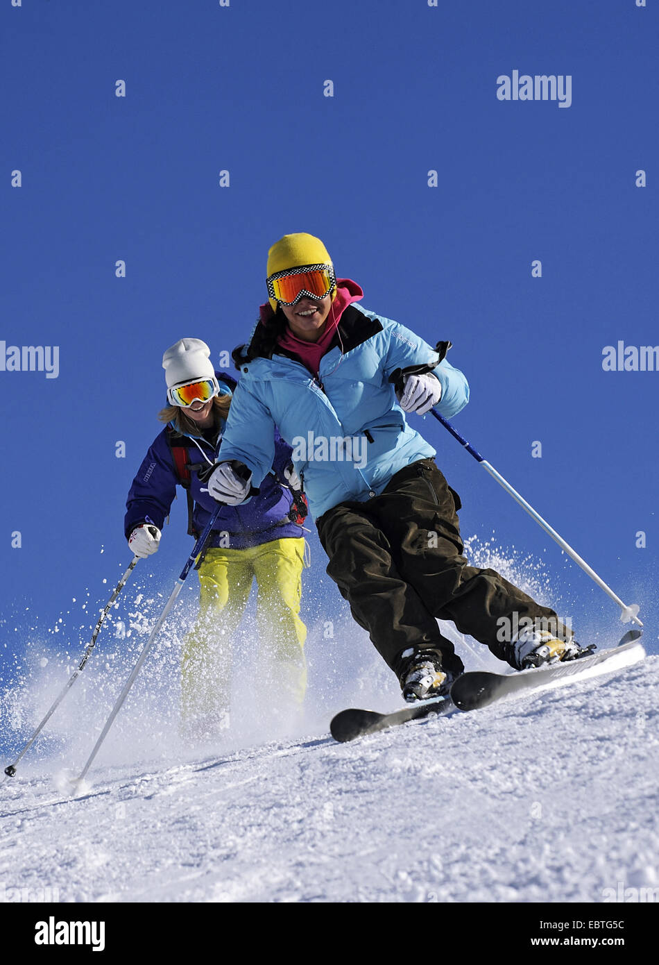 two skiers on ski run, France - Stock Image