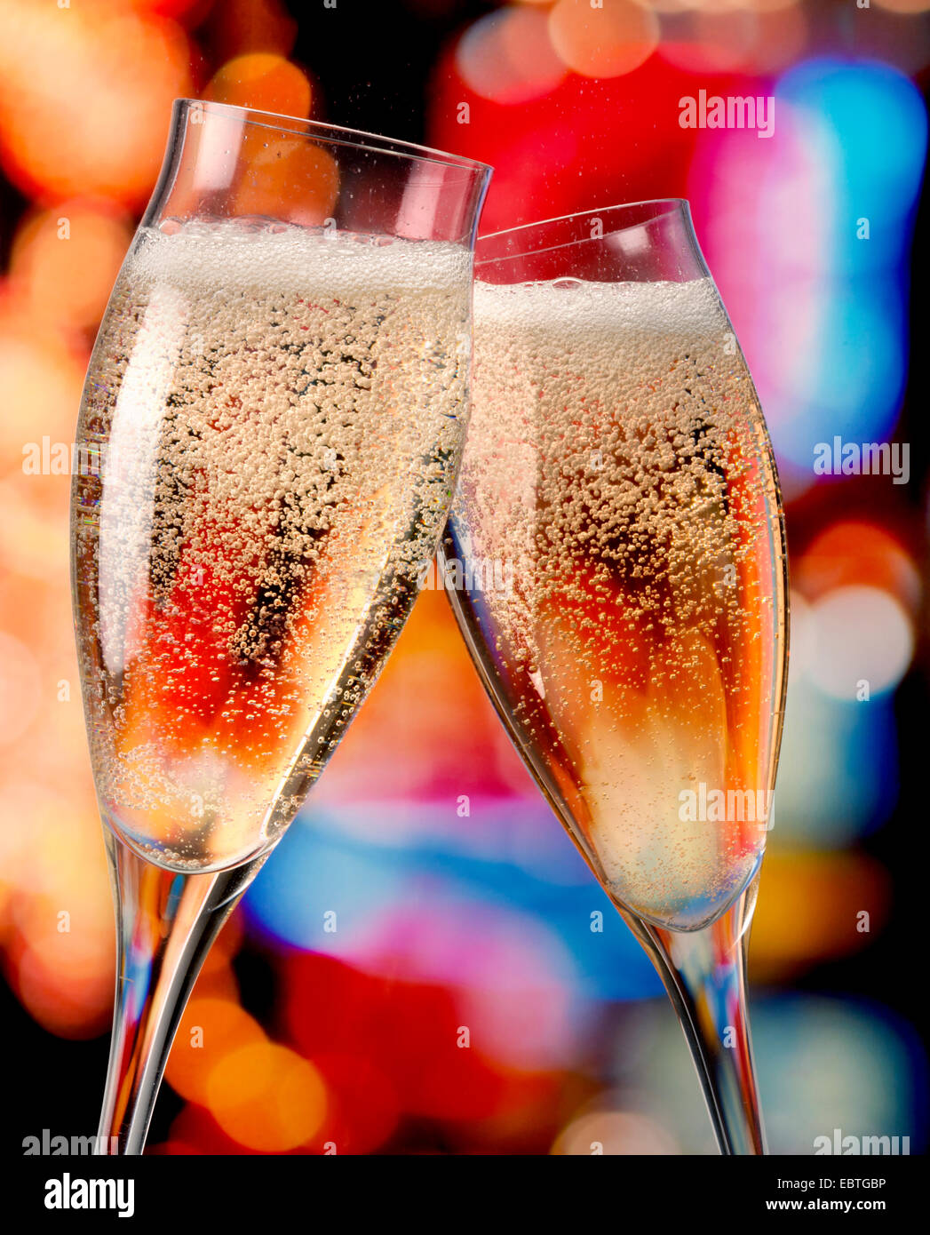 champagne glasses toasting - Stock Image
