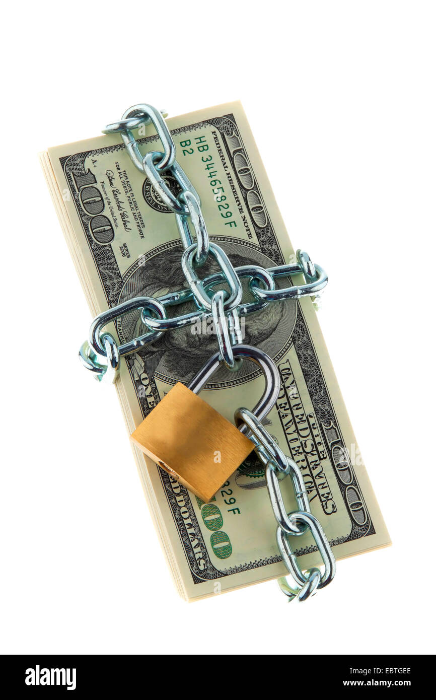 chain and padlock around a stack of U.S. dollars bills - symbolising safe investment - Stock Image