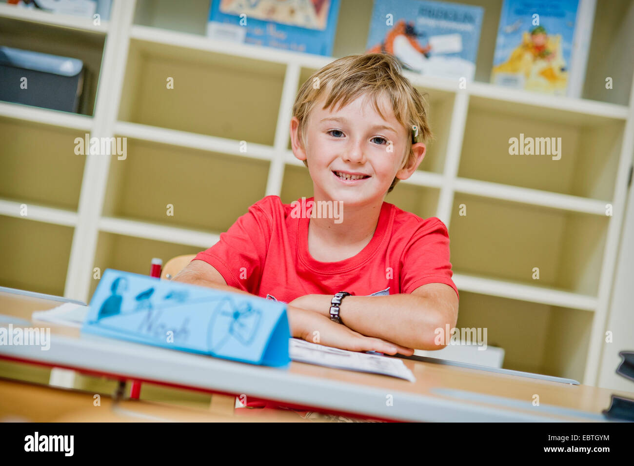 pupil sitting in the class - Stock Image