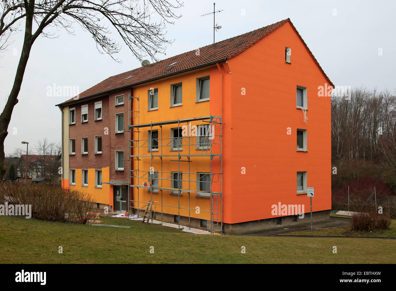 scaffold at a multi-storey residential building that is painted, Germany - Stock Image