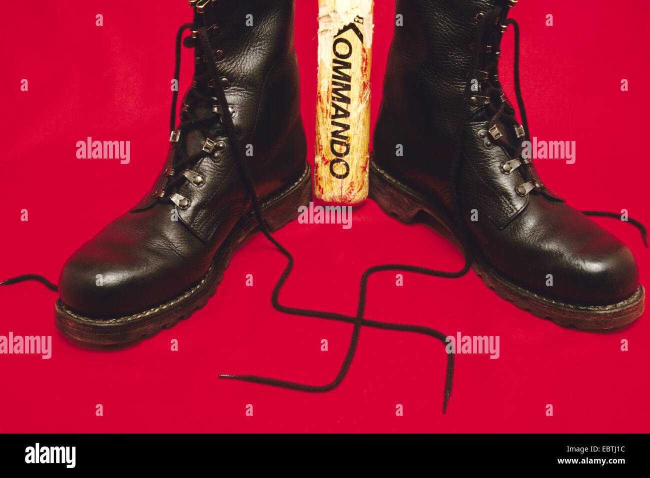 symbol picture 'neo-Nazi': baseball bat and combat boots with the shoelaces forming a swastika, Germany Stock Photo