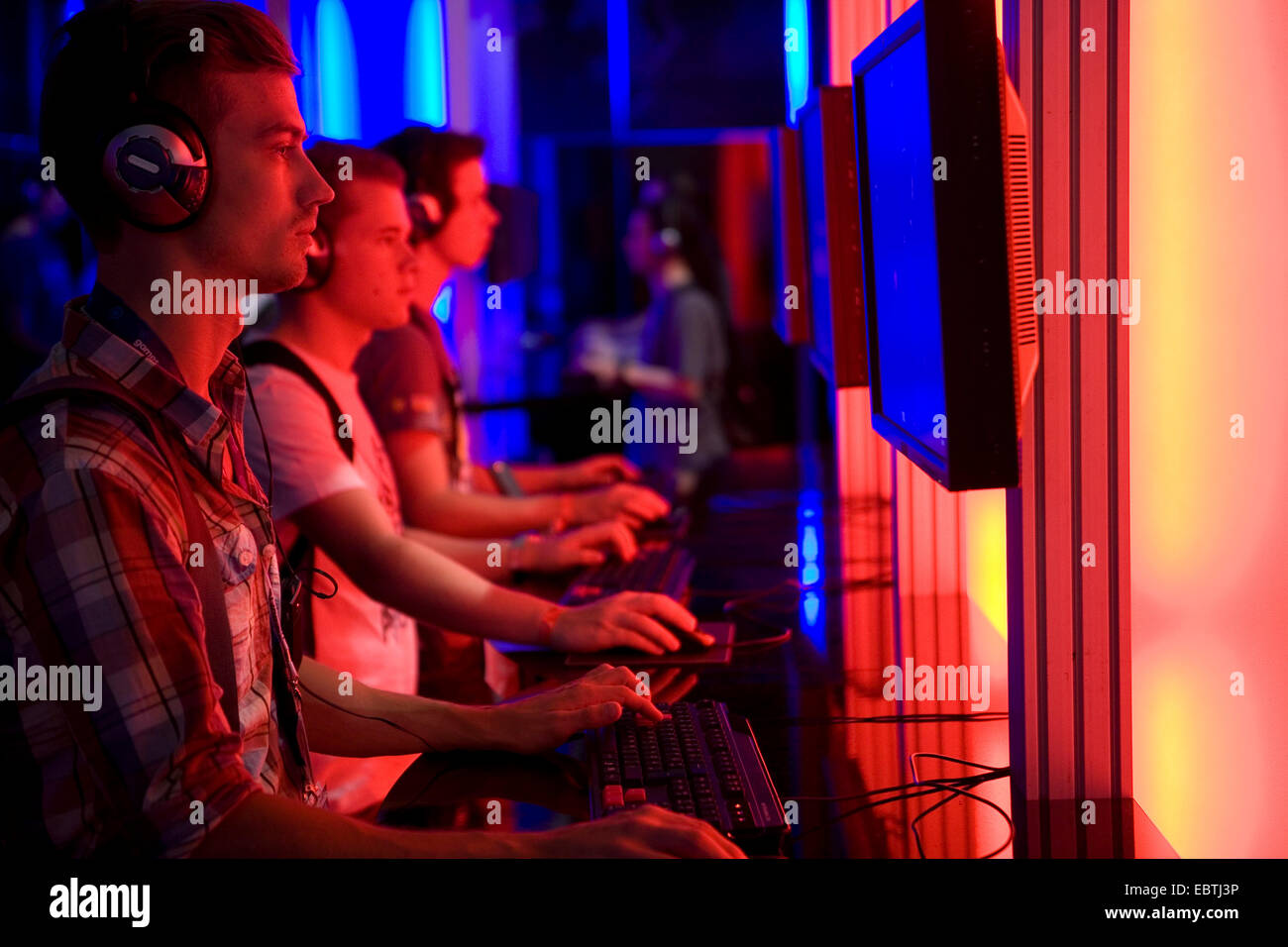 young visitors of the gamescom (the world's largest  trade fair for video games) testing new games, Germany - Stock Image