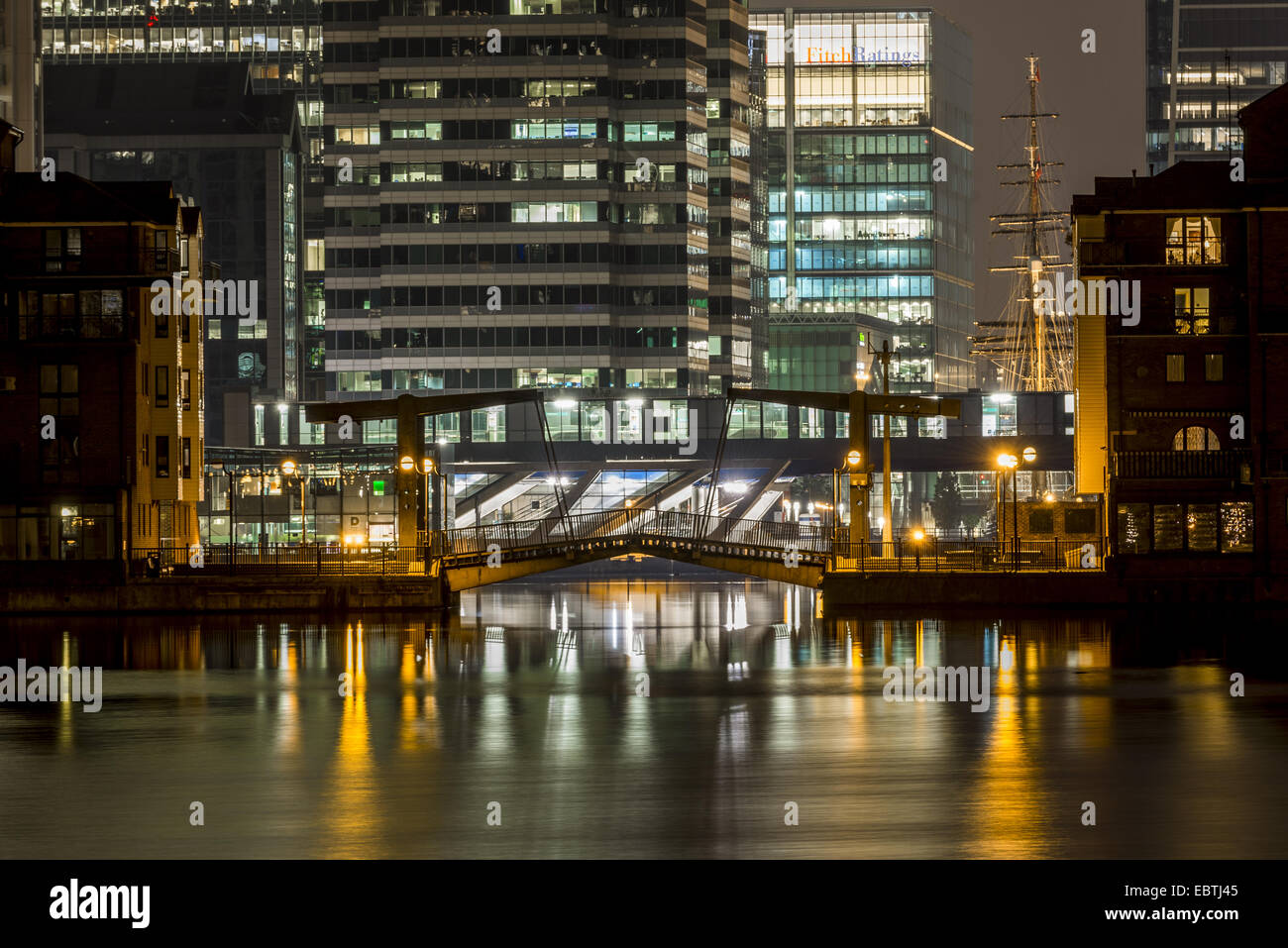 Millwall Dock is a dock at Millwall, south of Canary Wharf on the Isle of Dogs, London. Seen here at night. - Stock Image
