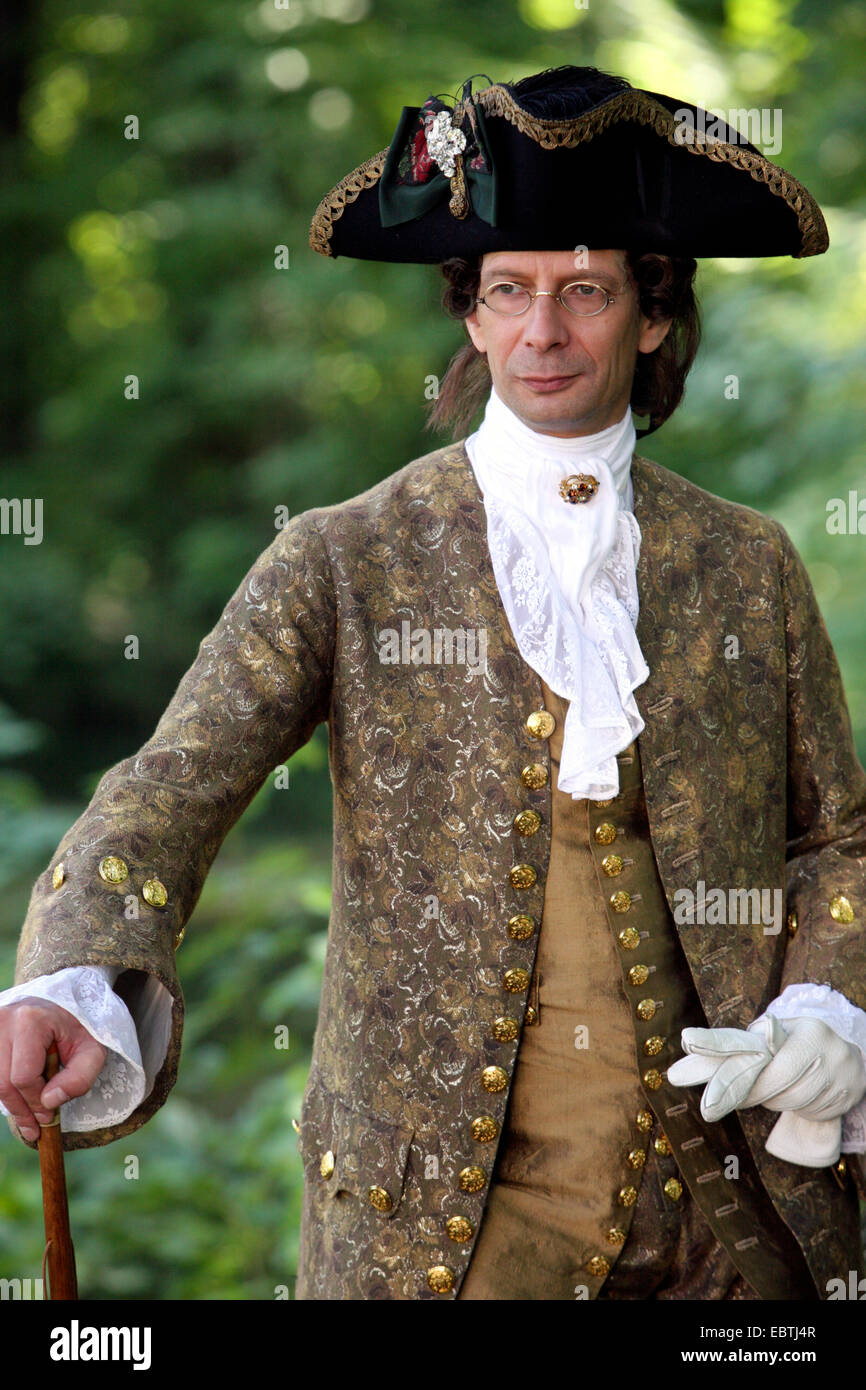 aristocrat standing in the garden in baroque clothing - Stock Image