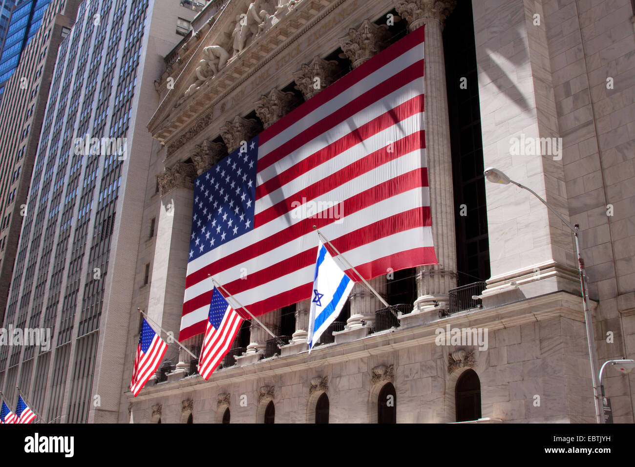 New York Stock Exchange with American Flags, USA, New York City - Stock Image