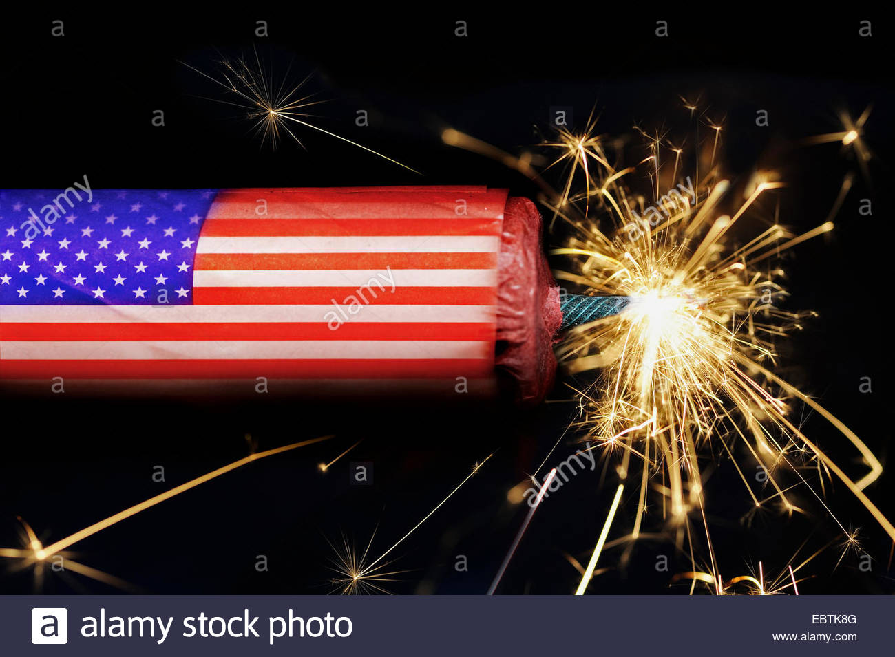 symbol picture 'national debt of the USA': a firecracker with the Star-Spangled Banner on it and with a - Stock Image