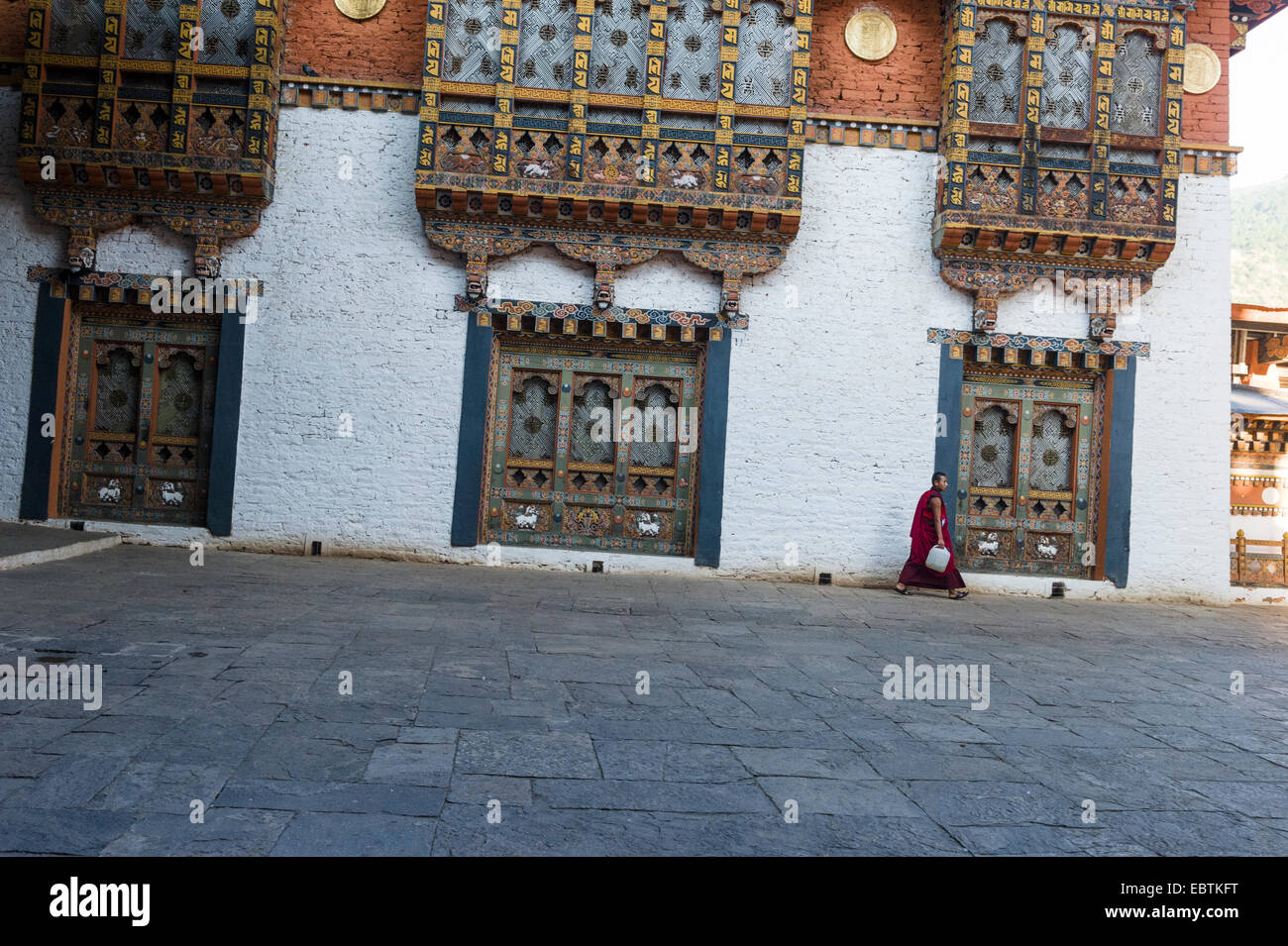 Punakha Dzong, with Monk walking through Courtyard, Bhutan - Stock Image