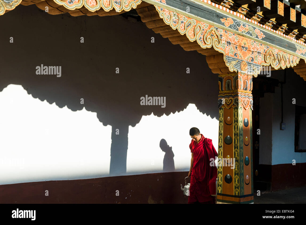 Monk Carrying Teapot, Punakha Dzong - Stock Image