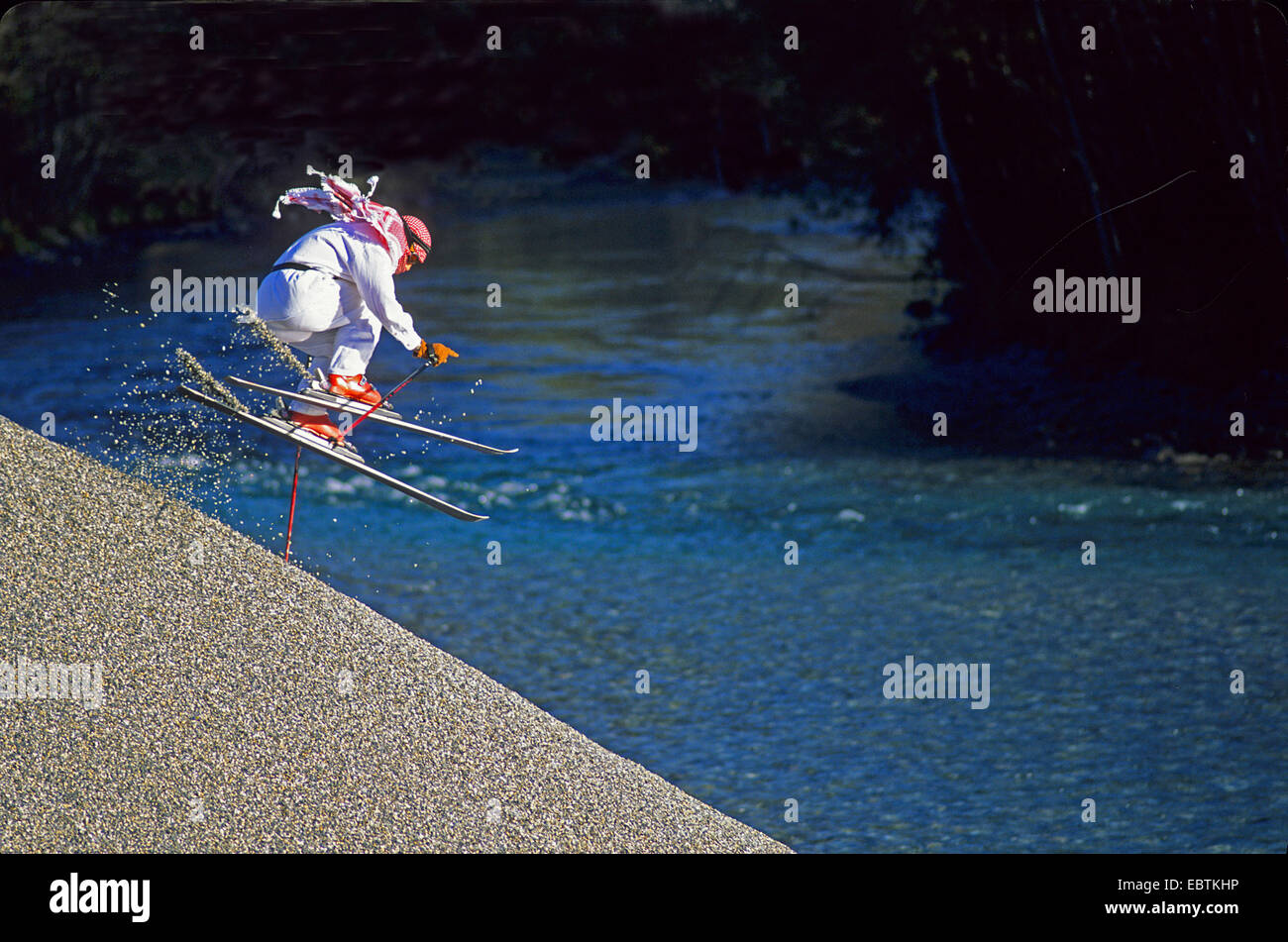 freeride skier disguised as sheik going downhill on gravel slope - Stock Image