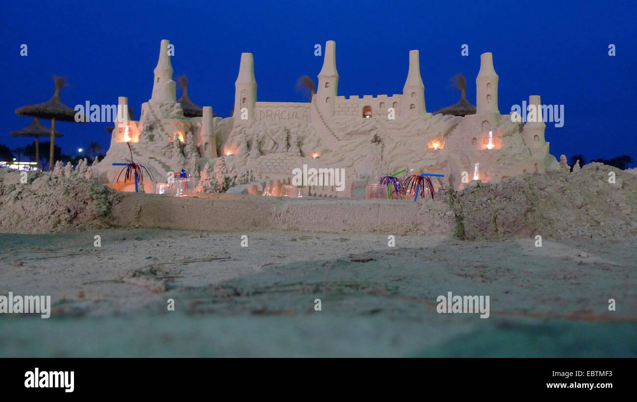 feudal sand castle at the beach in evening illumination, Spain, Balearen, Majorca, Alcudia - Stock Image