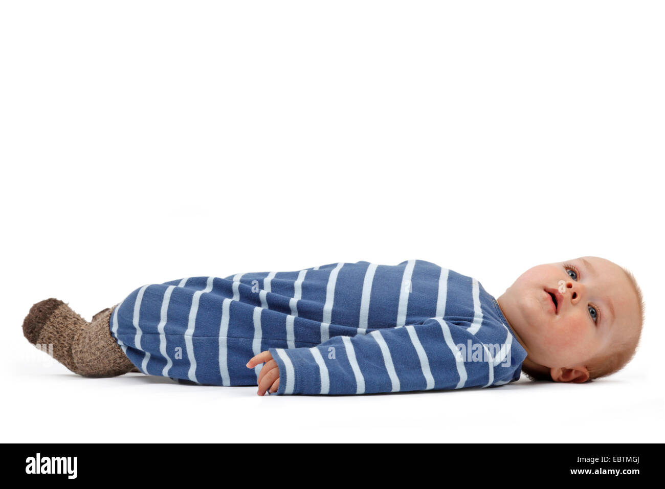 little boy in romper lying at the back - Stock Image