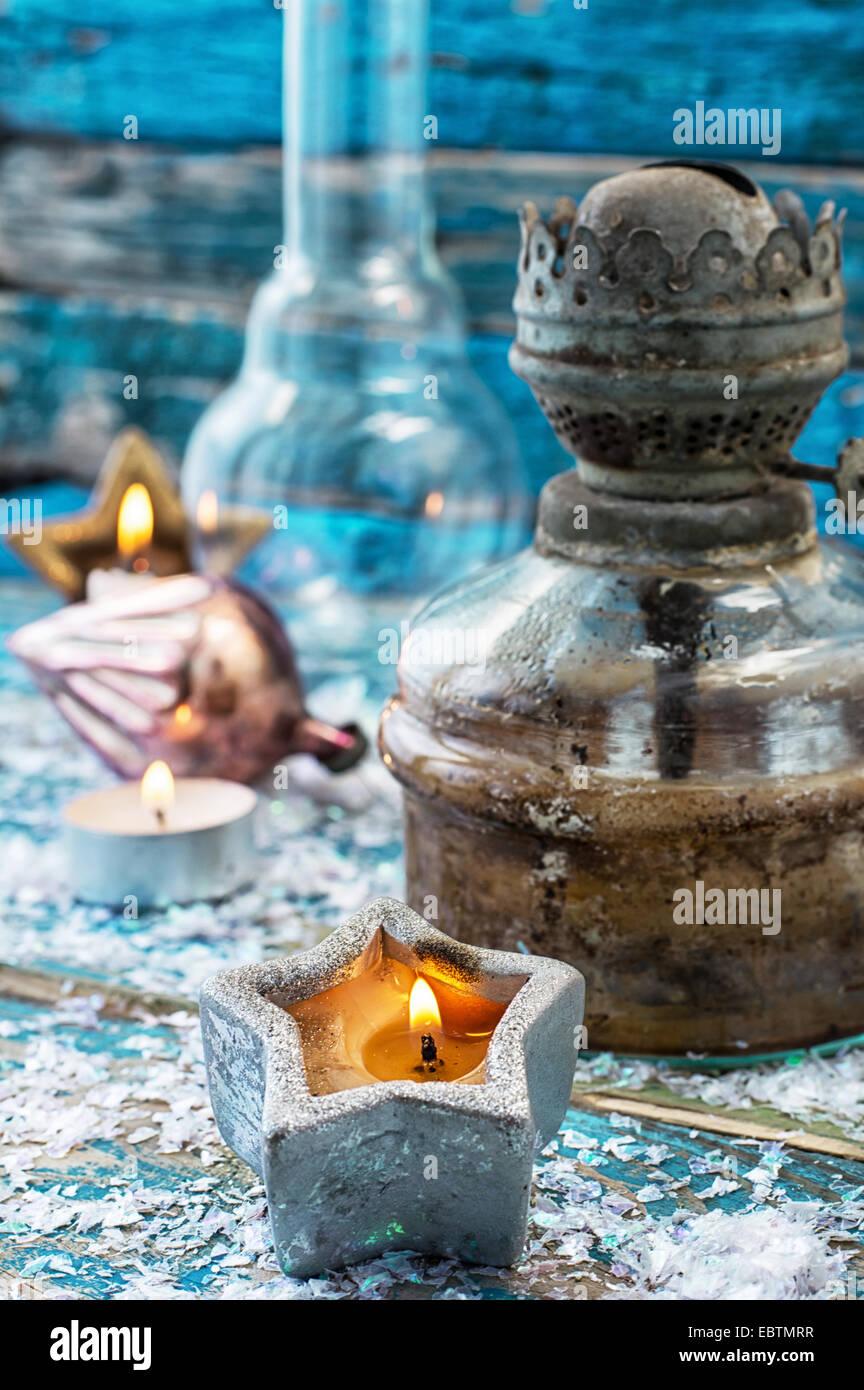 old-fashioned kerosene lamp and Christmas toys - Stock Image