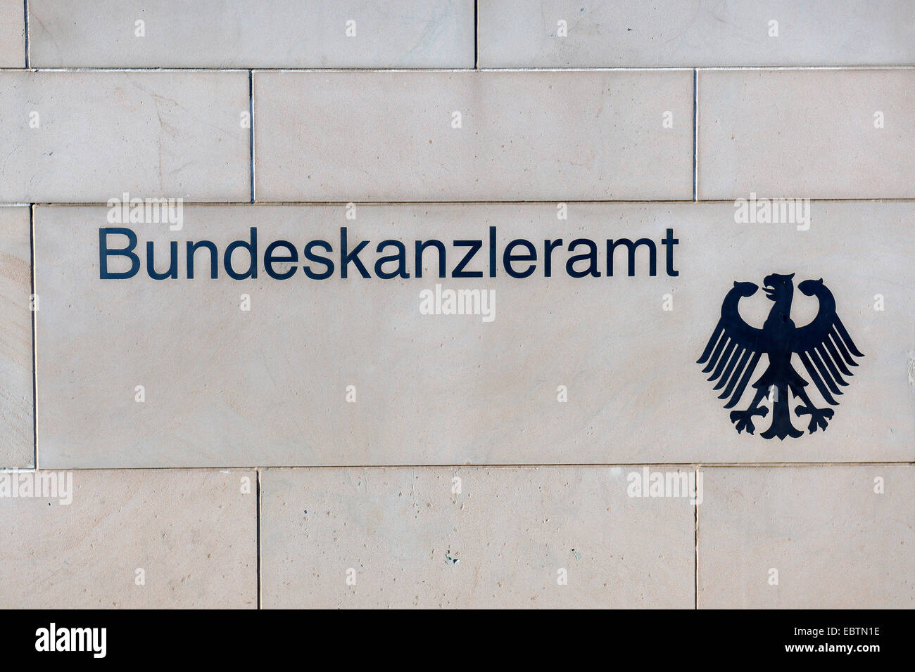 'Bundeskanzleramt' and federal eagle at the wall of German chancellery, Germany, Berlin Stock Photo