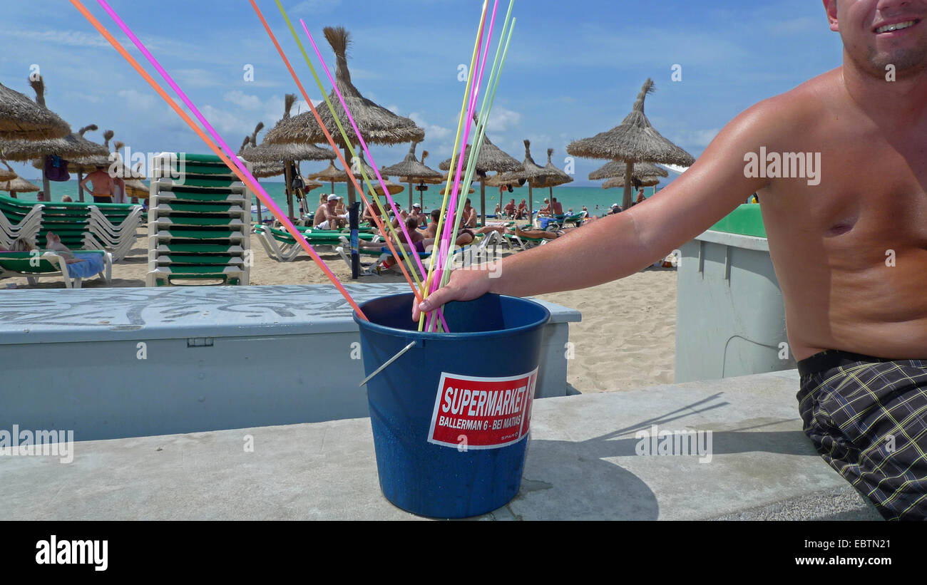 man with 10 litre bucket with Sangria and drinking straws at Ballermann, Spain, Balearen, Majorca, Palma Stock Photo