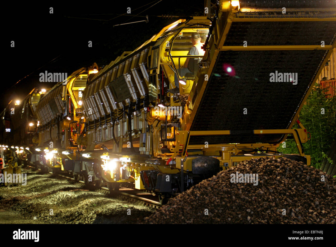 railway construction with hopper wagon at night, Germany, North Rhine-Westphalia - Stock Image