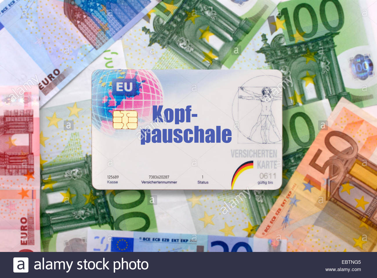 health insurance card with lable capitation fee lying on bills, Germany - Stock Image