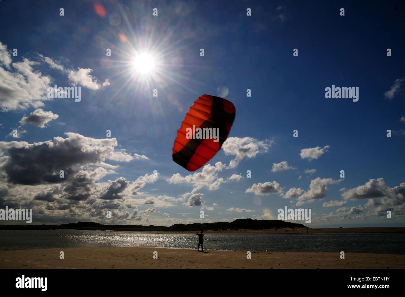 teenager with kite on the beach, Netherlands, Cadzand Stock Photo