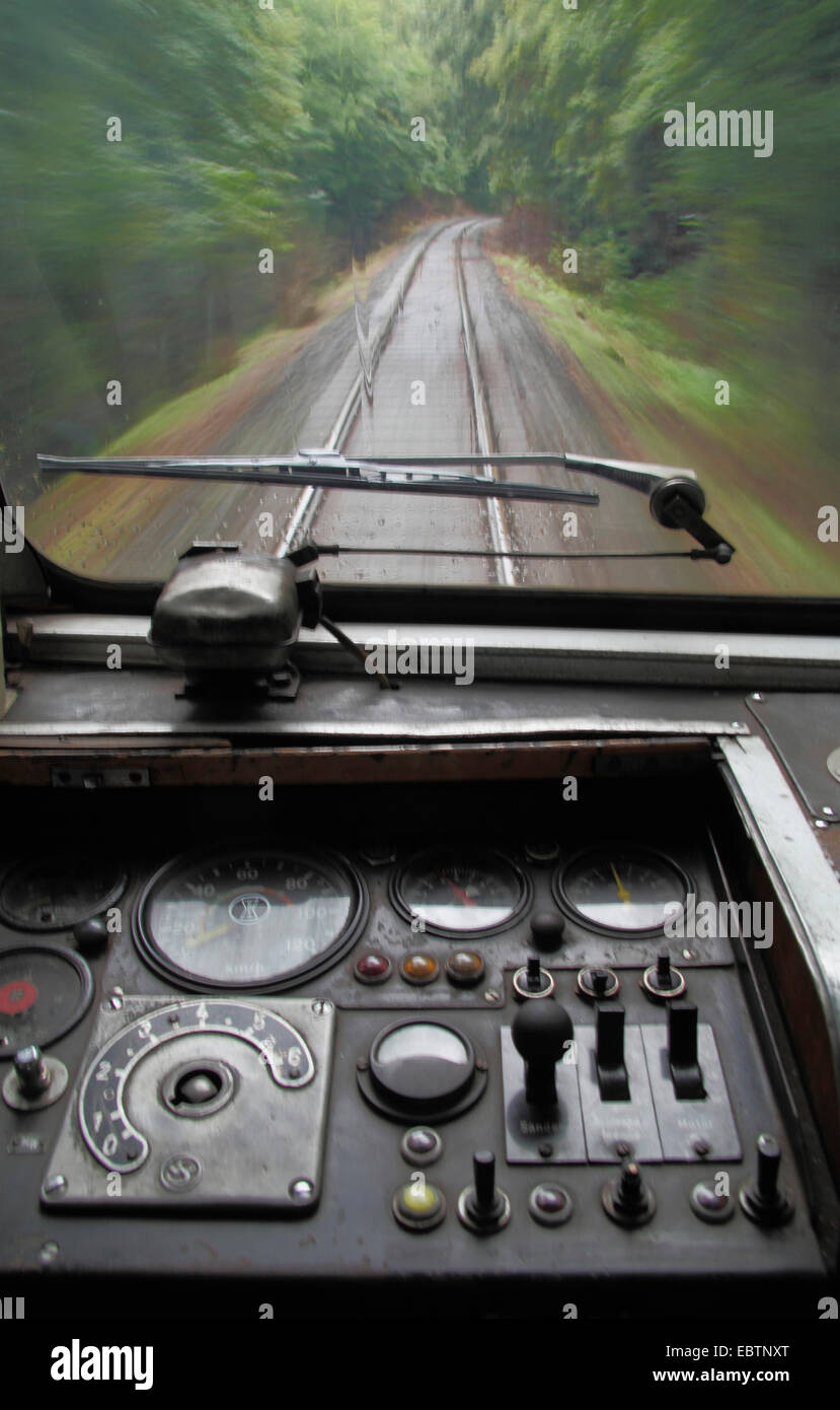view from cockpit of a train to the tracks - Stock Image